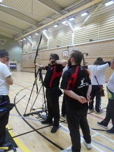 John Nicolls shooting bow and arrow at British Blind Indoor Archery Championship